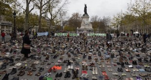 "The Place de la Republique is covered in hundreds of pairs of shoes on November 29, 2015 in downtown Paris, as part of a symbolic and peaceful rally called by the NGO Avaaz ""Paris sets off for climate"" within the UN conference on climate change COP21, as an attempt to get round the French authorities' ban on public gatherings. Paris has extended a ban on public gatherings introduced after the terror attacks in the French capital until November 30, the start of UN climate talks, where some 150 leaders will be tasked with reaching the first truly universal climate pact. The banner reads ""Paris sets off for climate"". AFP PHOTO / MIGUEL MEDINA / AFP / MIGUEL MEDINA        (Photo credit should read MIGUEL MEDINA/AFP/Getty Images)"